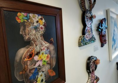Butterflies by Janine Wing and Mosaic death masks by Susie Chaikin